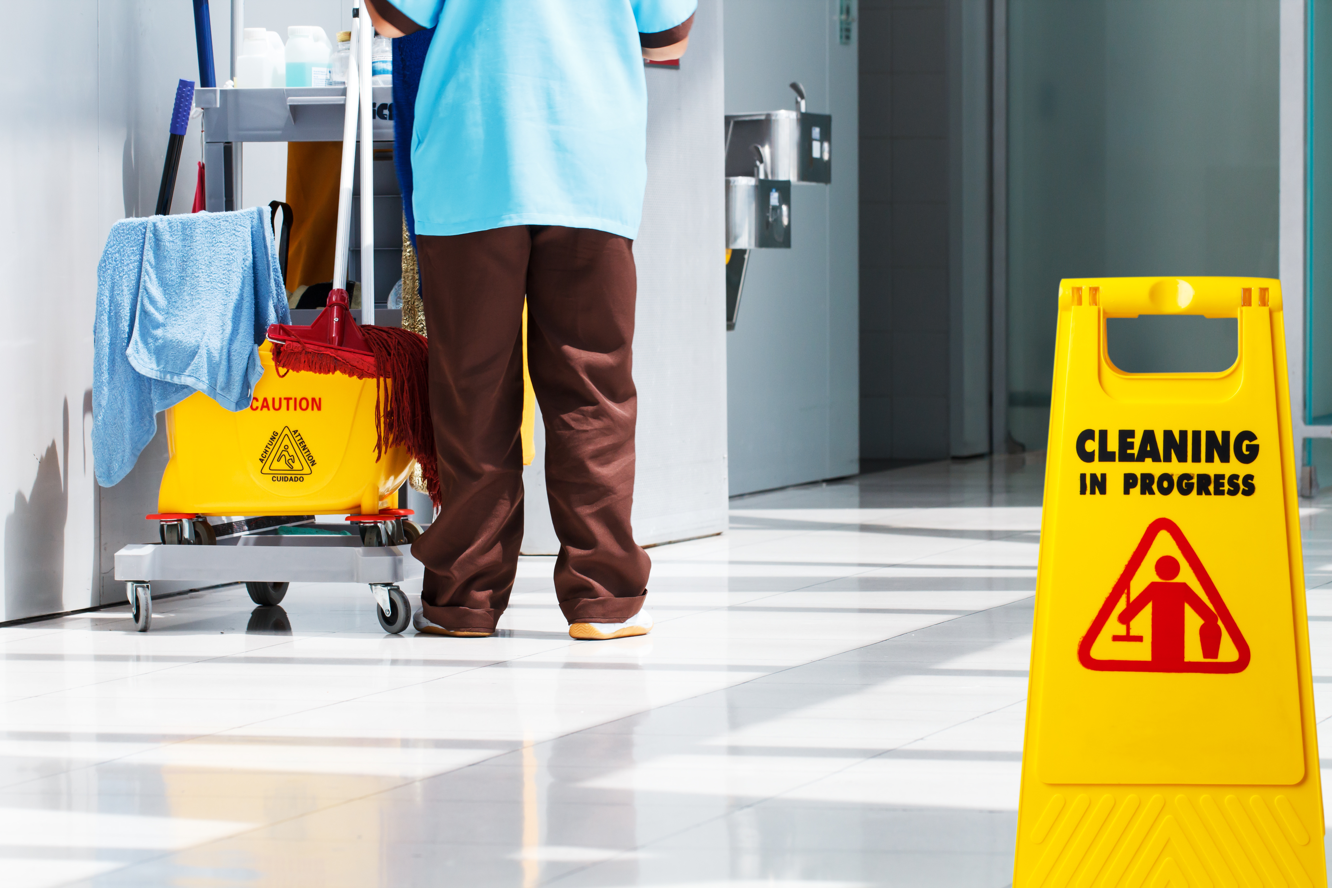 Janitorial and mop bucket on cleaning
